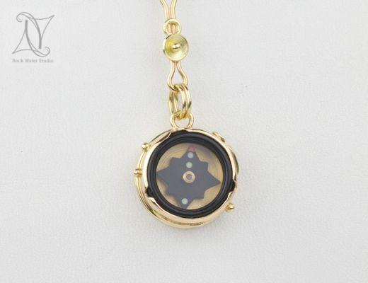 Elegant Rose Gold Compass Pendant