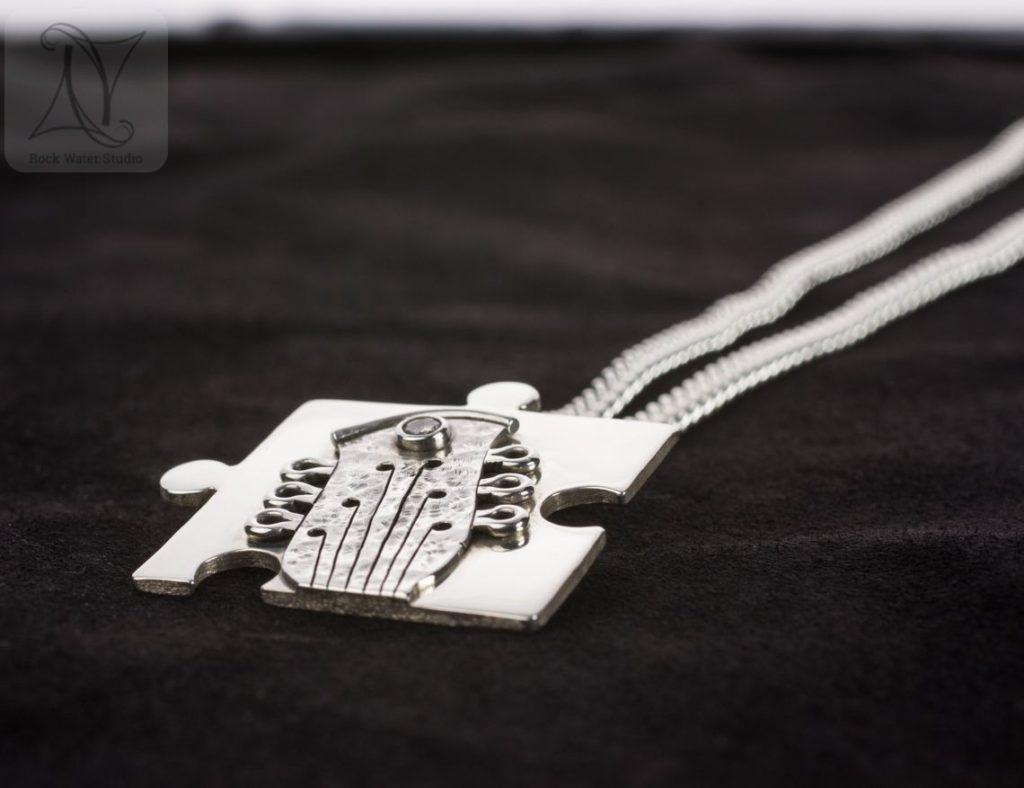 Silver Jigsaw Pendant