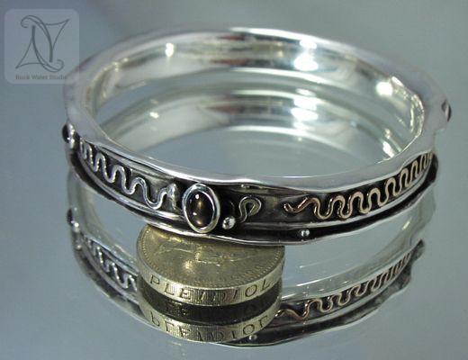 Handmade silver bangle with sapphires