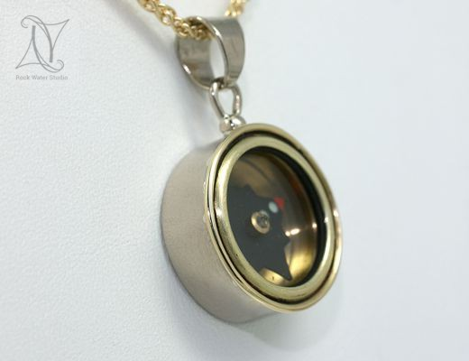 white gold compass necklace with yellow gold frame (g303)