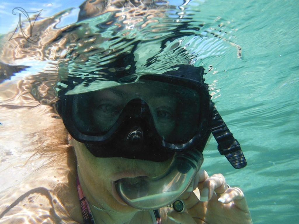 Diane wears her water resistant compass safely underwater