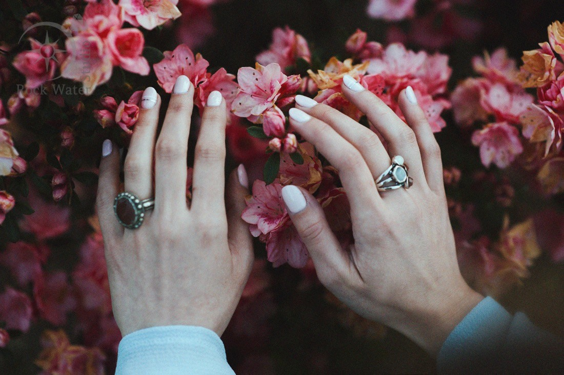 beautiful nourished manicured hands wearing rings